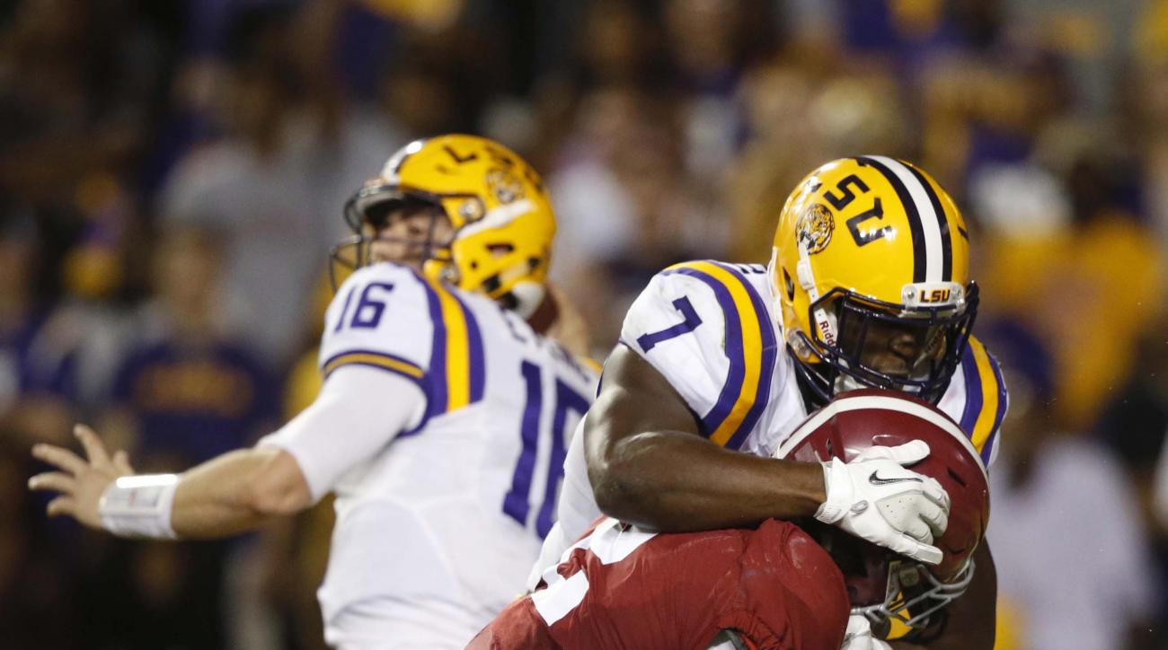 LSU running back Leonard Fournette (7) blocks Alabama defensive back Tony Brown as quarterback Danny Etling (16) passes in the second half of an NCAA college football game in Baton Rouge, La., Saturday, Nov. 5, 2016. Alabama won 10-0. (AP Photo/Gerald Her