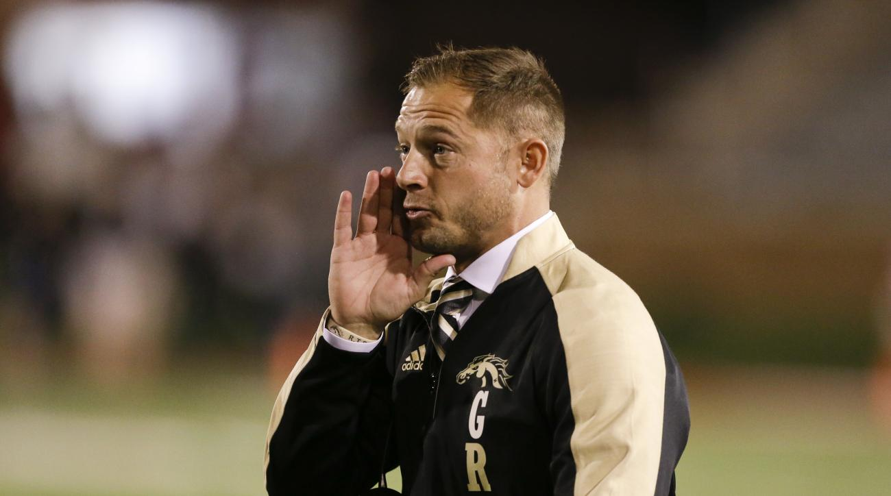 This Nov. 1, 2016 photo shows Western Michigan head coach P.J. Fleck during the first half of an NCAA college football game against Ball State in Muncie, Ind. When searching for a new head football coach, schools have been showing more willingness to hire