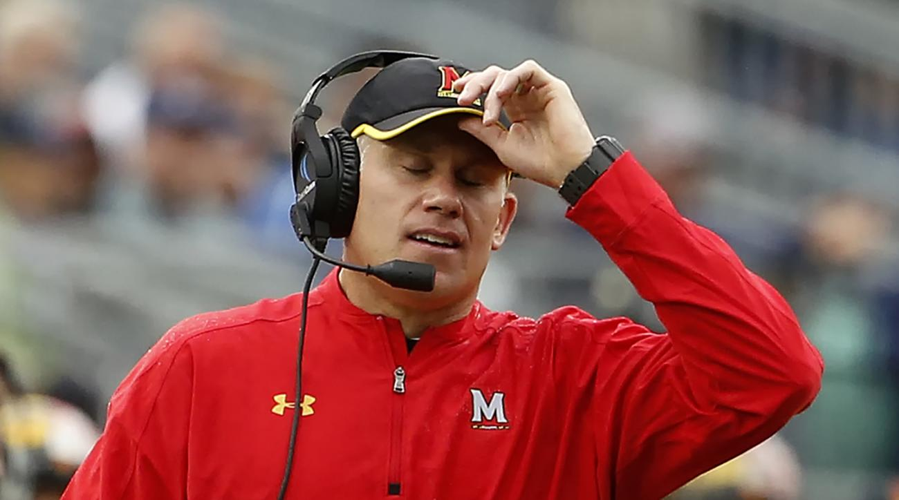 FILE - In this Oct. 8, 2016, file photo, Maryland head coach DJ Durkin reacts after Penn State scores during the second half of an NCAA college football game in State College, Pa. Durkin knew his first year at Maryland wasn't going to be easy. After absor
