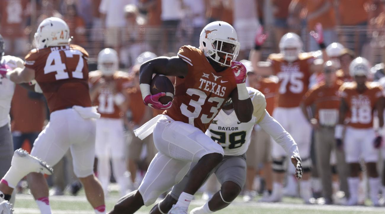 FILE - In this Oct. 29, 2016, file photo, Texas running back D'Onta Foreman (33) runs for a 37- yard touchdown against Baylor during the first half on a NCAA college football game, in Austin, Texas. Dede Westbrook is having the best stretch of games ever