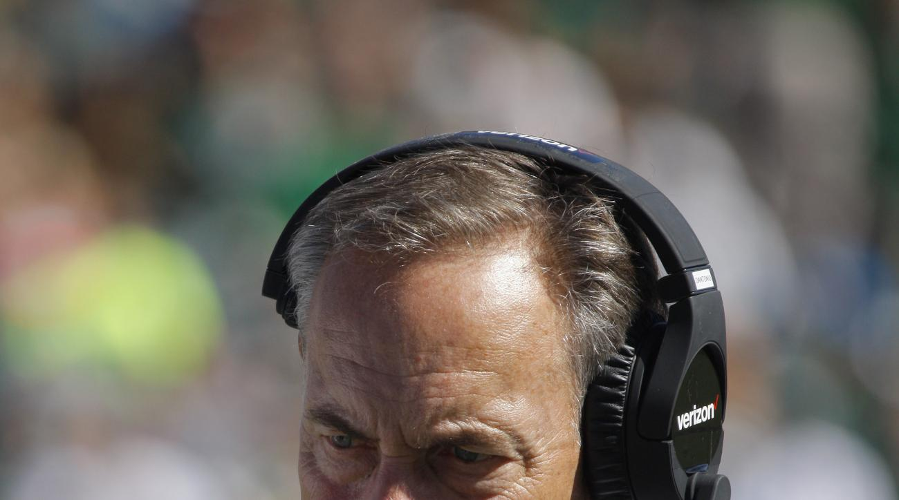 FILE - In this Sept. 24, 2016, file photo, Michigan State coach Mark Dantonio walks the sideline during the fourth quarter of a 30-6 loss to Wisconsin in an NCAA college football game in East Lansing, Mich. The fall of Michigan State could end up being th