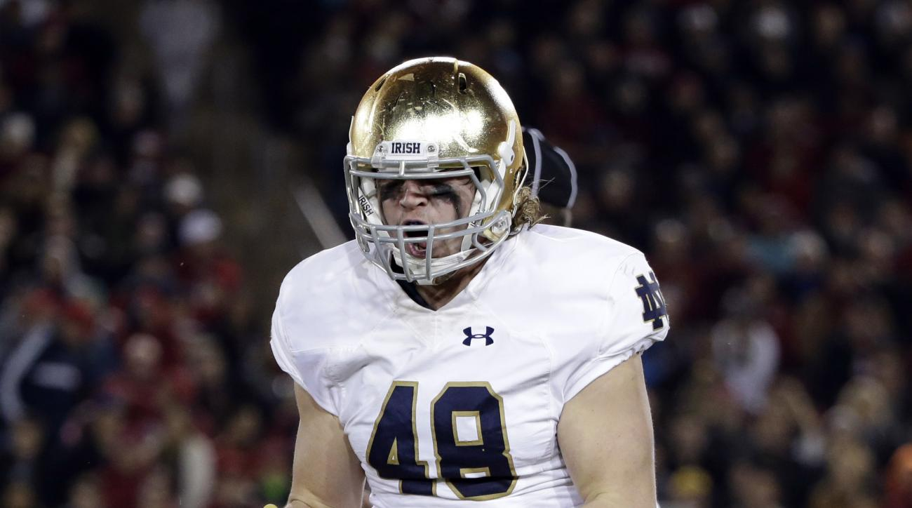 FILE - In this Nov. 28, 2015, file photo, Notre Dame linebacker Greer Martini (48) reacts during the first half of an NCAA college football game against Stanford in Stanford, Calif. Martini was so nervous before facing the triple option for the first time