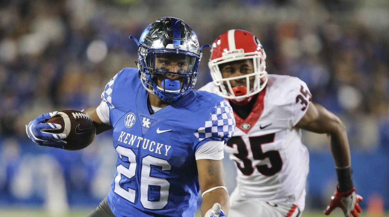FILe - In this Nov. 5, 2016, file photo, Kentucky running back Benny Snell Jr. is chased by Georgia during the second half of an NCAA college football game in Lexington, Ky. The return of some familiar faces has Tennessees defense feeling better about its