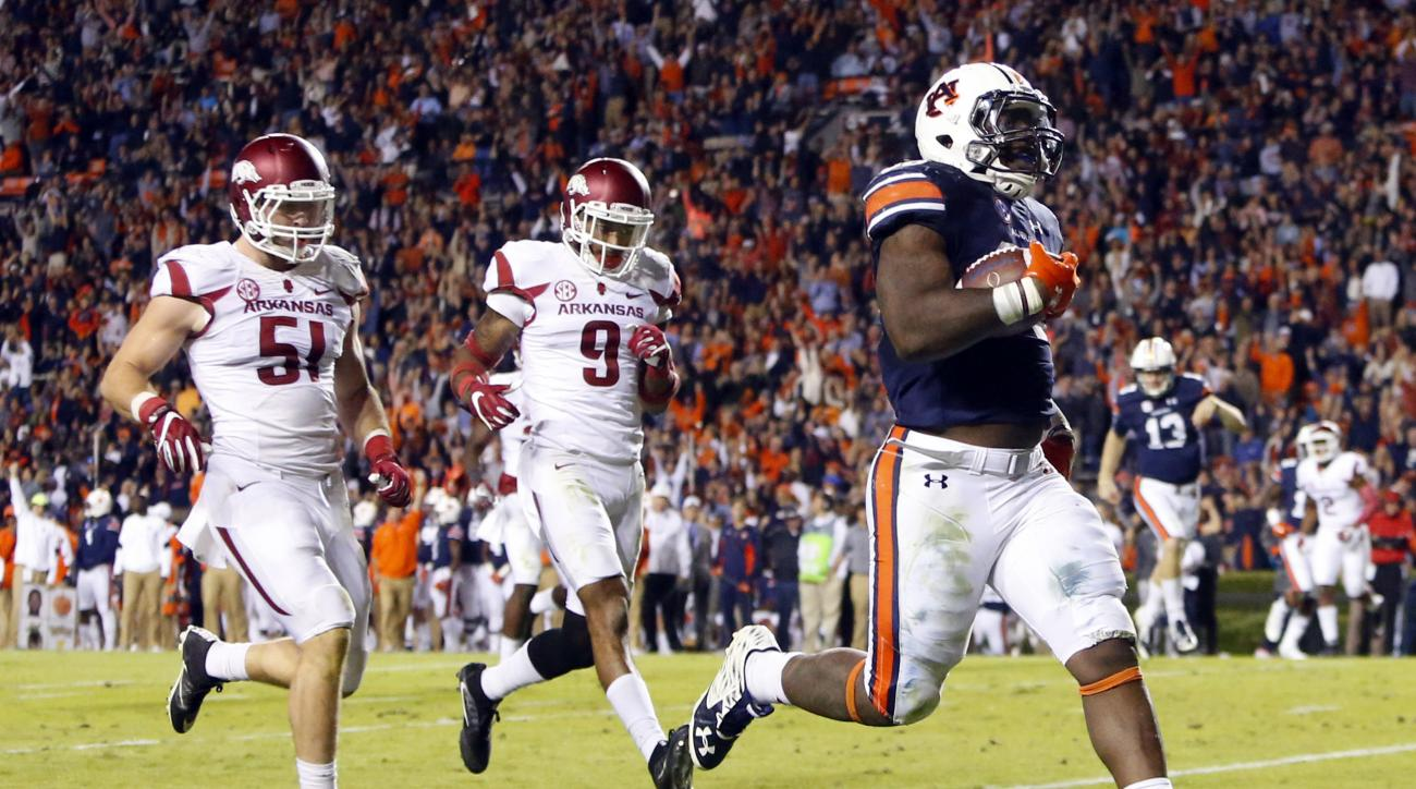 FILE - In this Oct. 22, 2016, file photo, Auburn running back Kamryn Pettway (36) scores a touchdown as he beats Arkansas linebacker Brooks Ellis (51) and defensive back Santos Ramirez (9) to the end zone during the second half of an NCAA college football