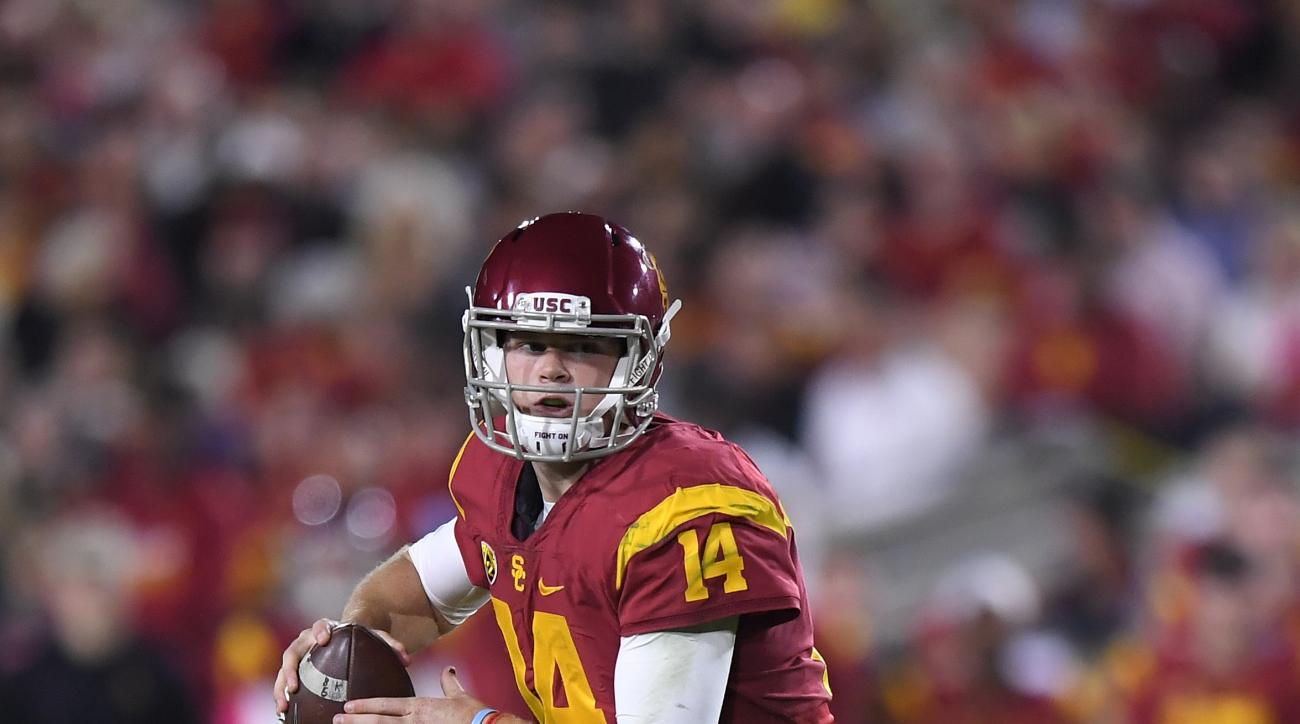 FILE - In this Oct. 27, 2016, file photo, Southern California quarterback Sam Darnold gets set to pass during the team's NCAA college football game against California in Los Angeles. If you havent seen USC since its 1-3 start, this team does not look much