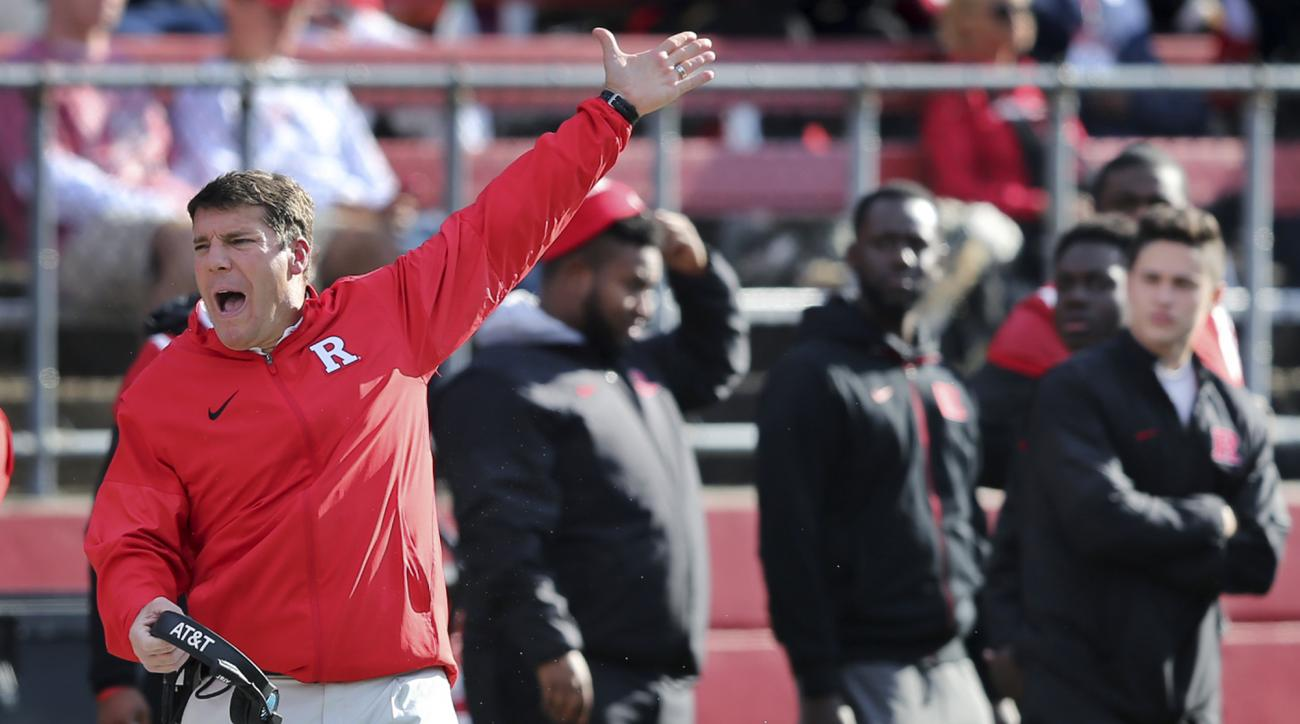 FILE - In this Nov. 5, 2016, file photo, Rutgers coach Chris Ash reacts to a call during the second half of the team's NCAA college football game against Indiana in Piscataway, N.J. Rutgers goes to Michigan State in a battle (or something) for last place