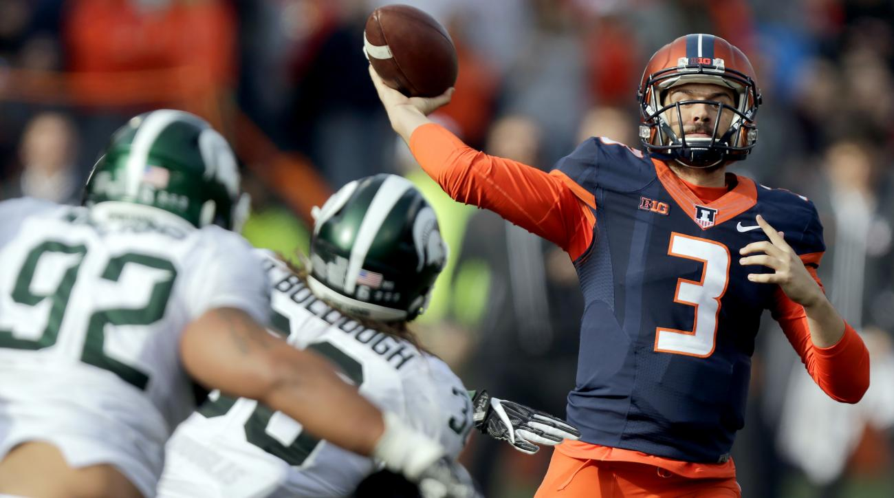 FILE - In this Nov. 5, 2016, file photo, Illinois quarterback Jeff George Jr. (3) passes against the defense of Michigan State linebacker Riley Bullough (30) and defensive tackle Kevin Williams (92) during an NCAA college football game in Champaign, Ill.