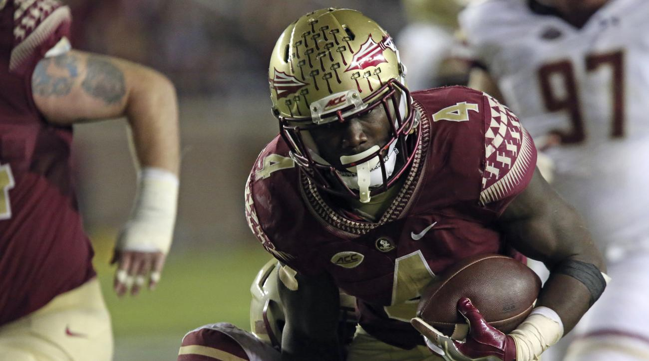 Florida State's Dalvin Cook runs against Boston College's defense in the third quarter of an NCAA college football game Friday, Nov. 11, 2016, in Tallahassee, Fla. Florida State won the game 45-7. (AP Photo/Steve Cannon)