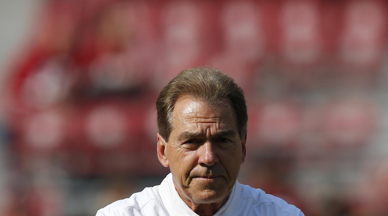 Alabama head coach Nick Saban walks the field before the first half of an NCAA college football game against Mississippi State, Saturday, Nov. 12, 2016, in Tuscaloosa, Ala. (AP Photo/Brynn Anderson)