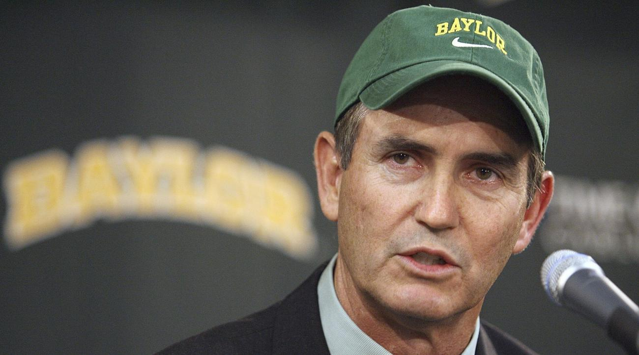FILE - In this Nov. 28, 2007, file photo, Art Briles answers questions after being introduced as the new coach of the Baylor University football team during a press conference in Waco, Texas. Baylor University has explained for the first time how Briles,