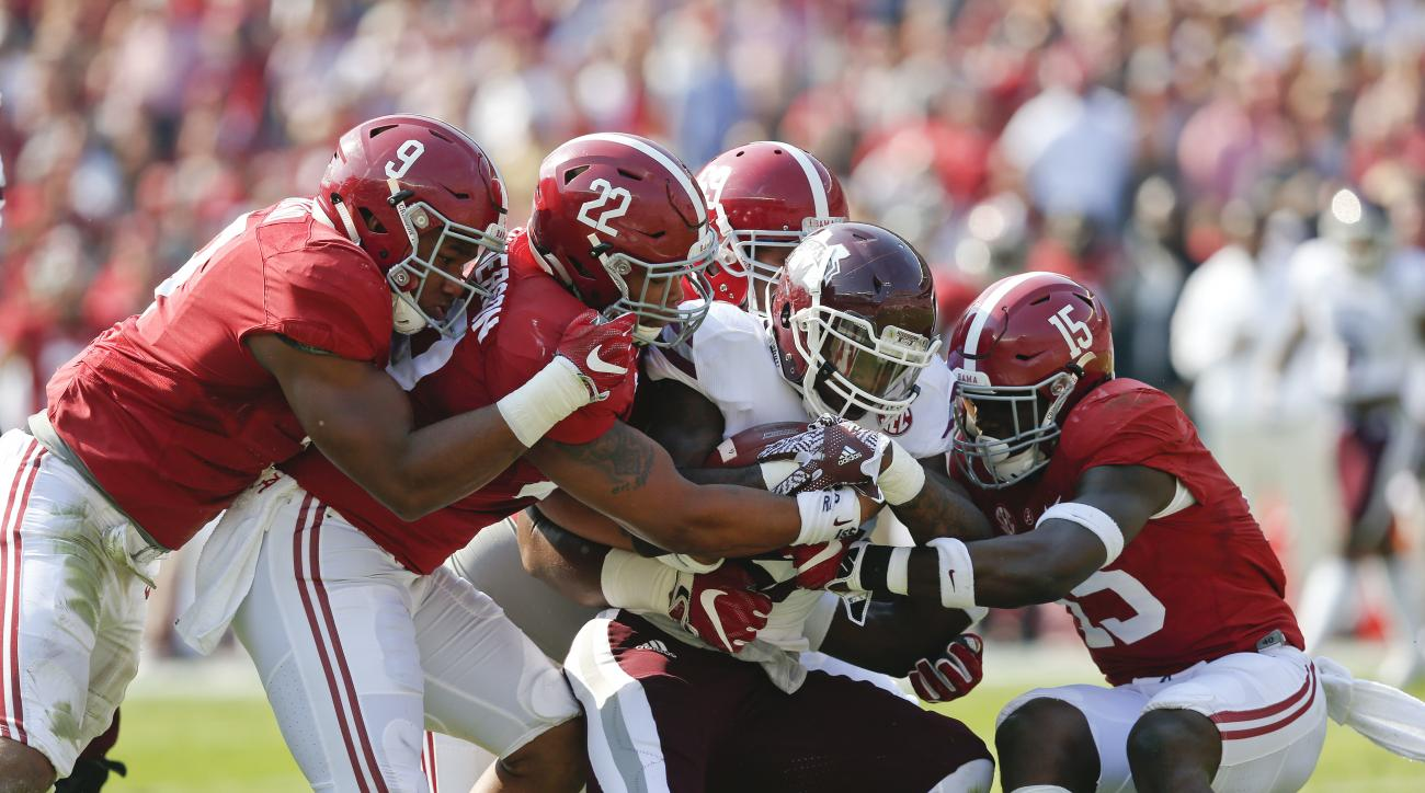 Mississippi State running back Aeris Williams, center, is tackled by Alabama defenders during the first half of an NCAA college football game, Saturday, Nov. 12, 2016, in Tuscaloosa, Ala. (AP Photo/Brynn Anderson)