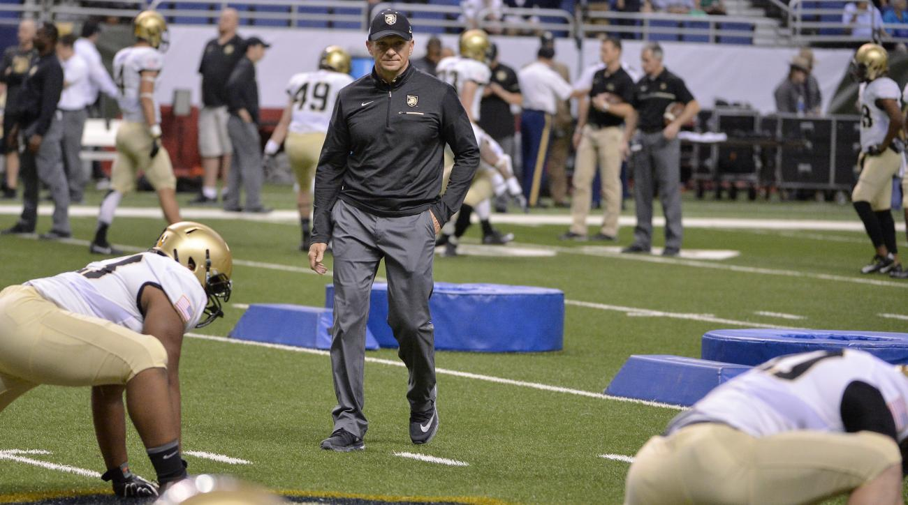 Army head coach Jeff Monken, center, watches his players warm up before an NCAA college football game against Notre Dame, Saturday, Nov. 12, 2016, in San Antonio. (AP Photo/Darren Abate)