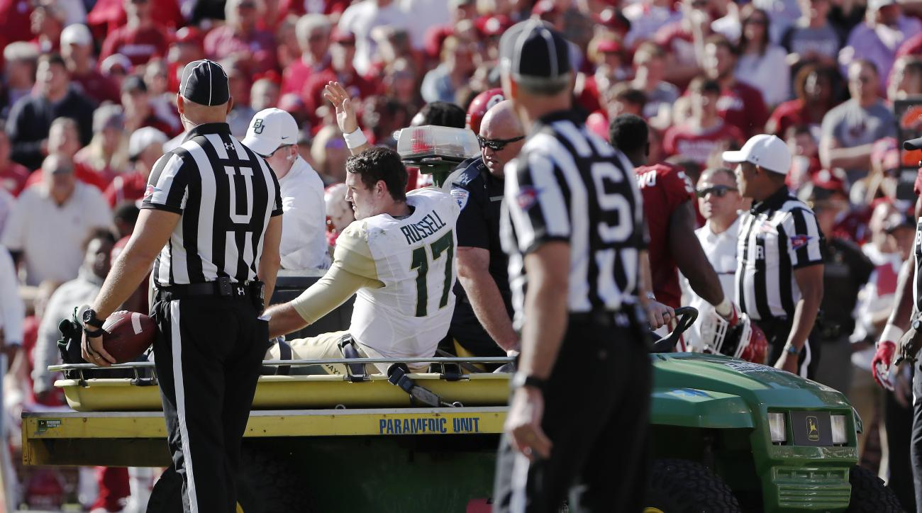 Baylor quarterback Seth Russell (17) waves to the crowd as he is carted off the field after an injury in the second half of a NCAA college football game against Oklahoma in Norman, Okla. on Saturday, Nov. 12, 2016. Oklahoma won 45-24. (AP Photo/Alonzo Ada