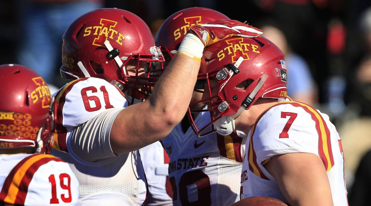 Iowa State quarterback Joel Lanning (7) is congratulated by teammate Brian Bobek (61) after scoring a touchdown during the second half of an NCAA college football game against Kansas in Lawrence, Kan., Saturday, Nov. 12, 2016. Iowa State defeated Kansas 3
