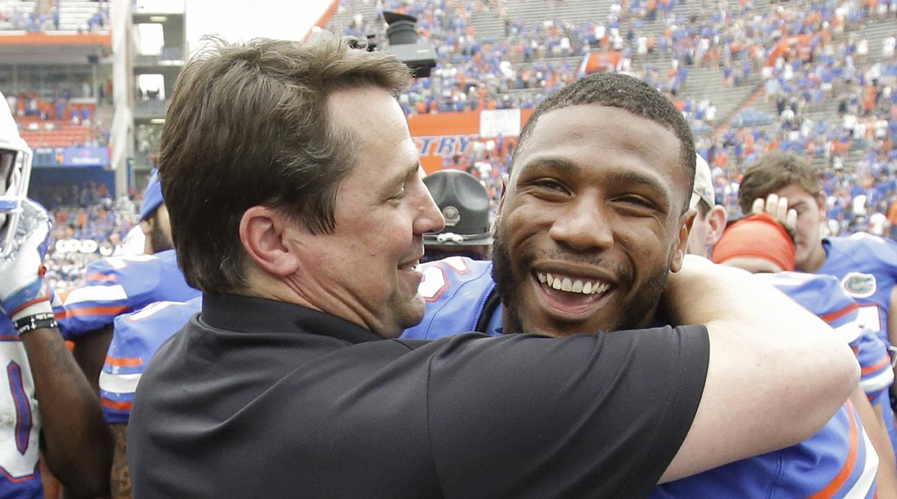 South Carolina head coach Will Muschamp, left, greets Florida linebacker Daniel McMillian (13) after an NCAA college football game, Saturday, Nov. 12, 2016, in Gainesville, Fla. Many Florida players greeted Muschamp, the former Florida coach, after the ga