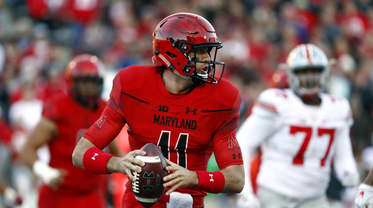 Maryland quarterback Perry Hills looks for a receiver in the first half of an NCAA college football game against Ohio State in College Park, Md., Saturday, Nov. 12, 2016. (AP Photo/Patrick Semansky)