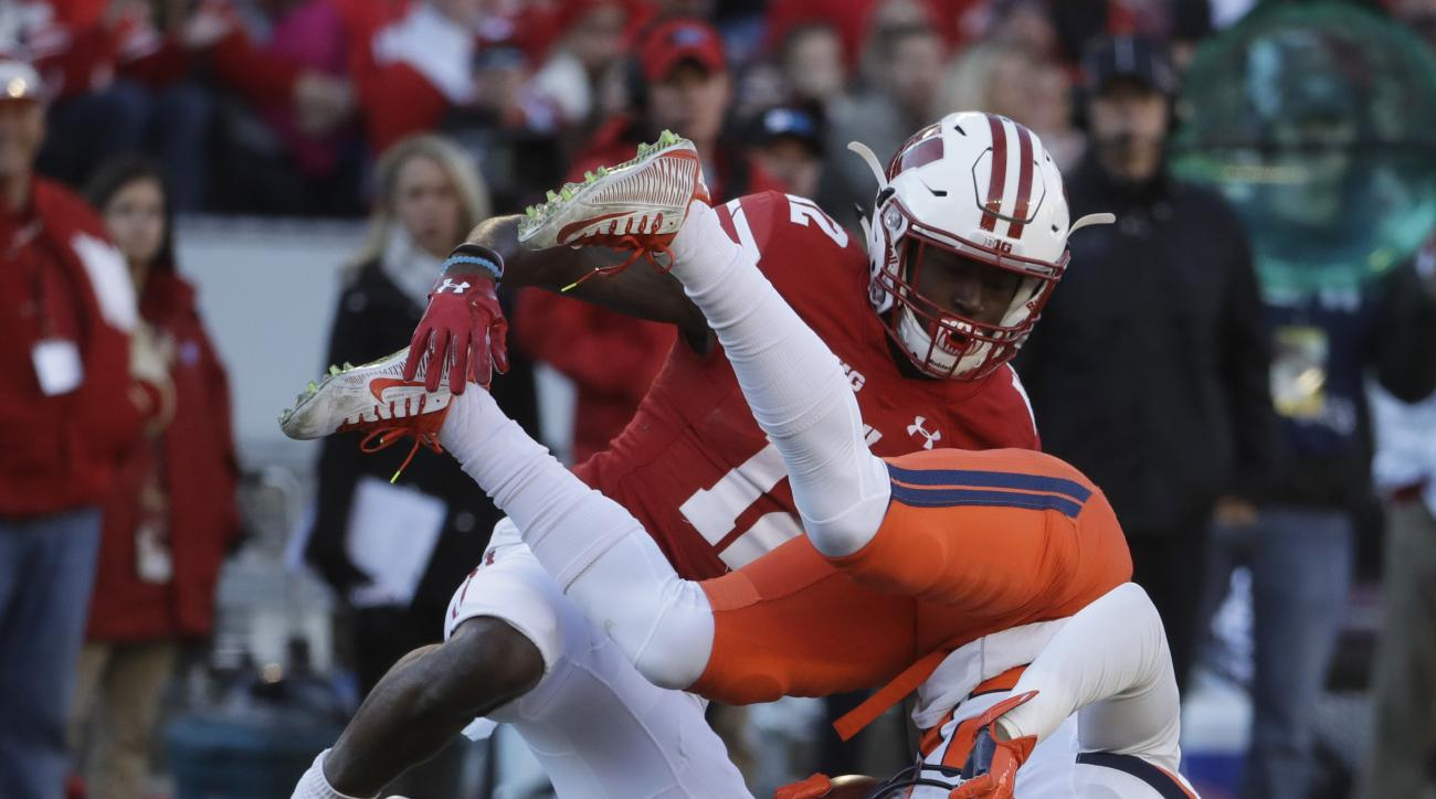 Wisconsin's Natrell Jamerson tackles Illinois's Darius Mosely during the first half of an NCAA college football game Saturday, Nov. 12, 2016, in Madison, Wis. (AP Photo/Morry Gash)