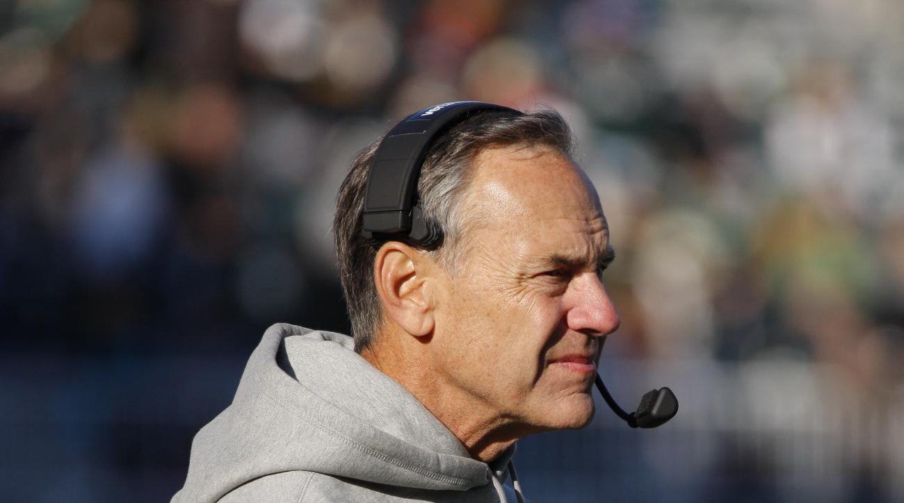 Michigan State coach Mark Dantonio watches the action against Rutgers during the fourth quarter of an NCAA college football game, Saturday, Nov. 12, 2016, in East Lansing, Mich. Michigan State won 49-0. (AP Photo/Al Goldis)