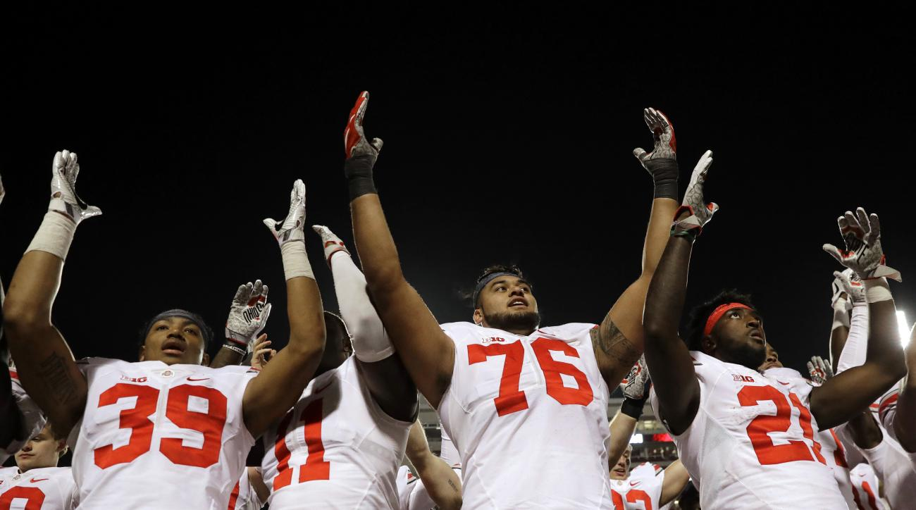 Ohio State players sing after an NCAA college football game against Maryland in College Park, Md., Saturday, Nov. 12, 2016. (AP Photo/Patrick Semansky)