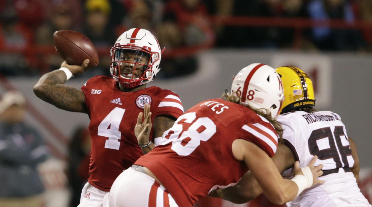 Nebraska quarterback Tommy Armstrong Jr. (4) throws as offensive lineman Nick Gates (68) blocks Minnesota defensive lineman Steven Richardson (96) during the first half of an NCAA college football game in Lincoln, Neb., Saturday, Nov. 12, 2016. (AP Photo/