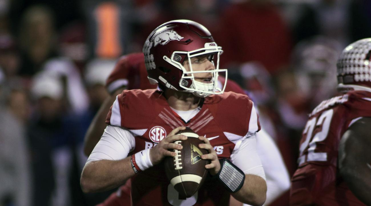 Arkansas' Austin Allen (8) looks to pass the ball during the second half of an NCAA college football game against LSU, Saturday, Nov. 12, 2016, in Fayetteville, Ark. LSU beat Arkansas 38-10. (AP Photo/Samantha Baker)