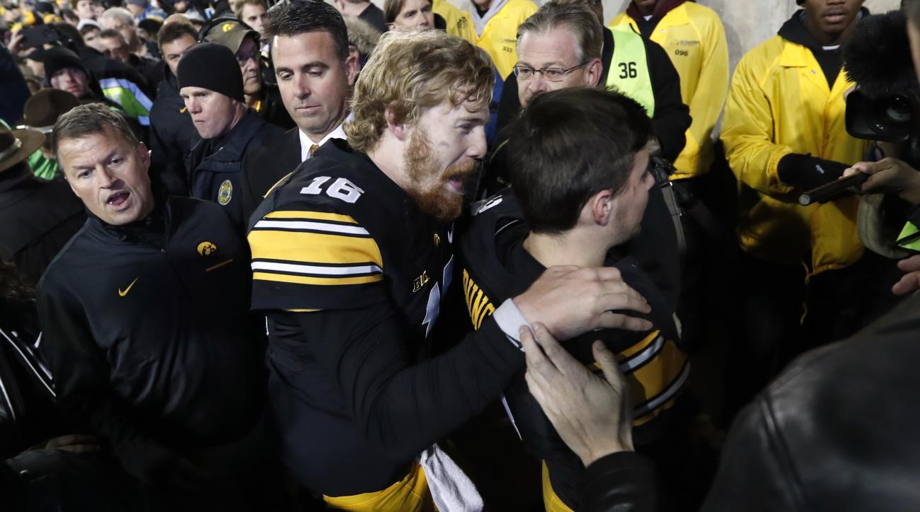 Iowa quarterback C.J. Beathard (16) celebrates with kicker Keith Duncan after an NCAA college football game against Michigan, Saturday, Nov. 12, 2016, in Iowa City, Iowa. Iowa won 14-13. (AP Photo/Charlie Neibergall)