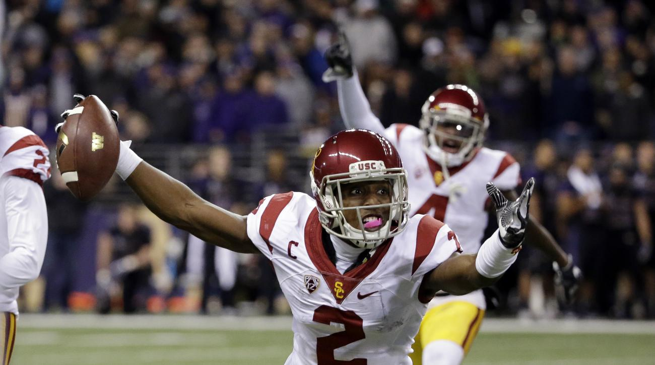 Southern California defensive back Adoree' Jackson (2) reacts after intercepting a Washington pass during the second half of an NCAA college football game Saturday, Nov. 12, 2016, in Seattle. USC won 26-13. (AP Photo/Elaine Thompson)