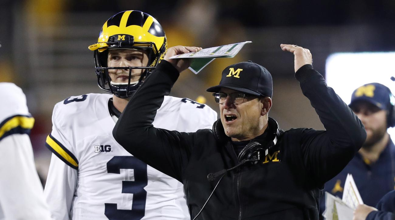 Michigan coach Jim Harbaugh reacts to a call in front of quarterback Wilton Speight (3) during the second half of an NCAA college football game against Iowa, Saturday, Nov. 12, 2016, in Iowa City, Iowa. Iowa won 14-13. (AP Photo/Charlie Neibergall)
