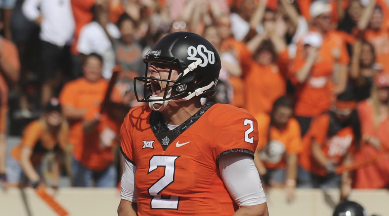 FILE - In this Oct. 29, 2016, file photo, Oklahoma State quarterback Mason Rudolph screams after scoring a touchdown in the third quarter of an NCAA college football game against West Virginia, in Stillwater, Okla. After escaping with a 45-44 victory over