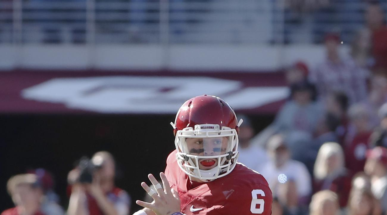 FILe - In this Nov. 12, 2016, file photo, Oklahoma quarterback Baker Mayfield (6) looks for a receiver during the first half of a NCAA college football game against Baylor, in Norman, Okla. A wacky weekend in college football has brought life to No. 8 Okl