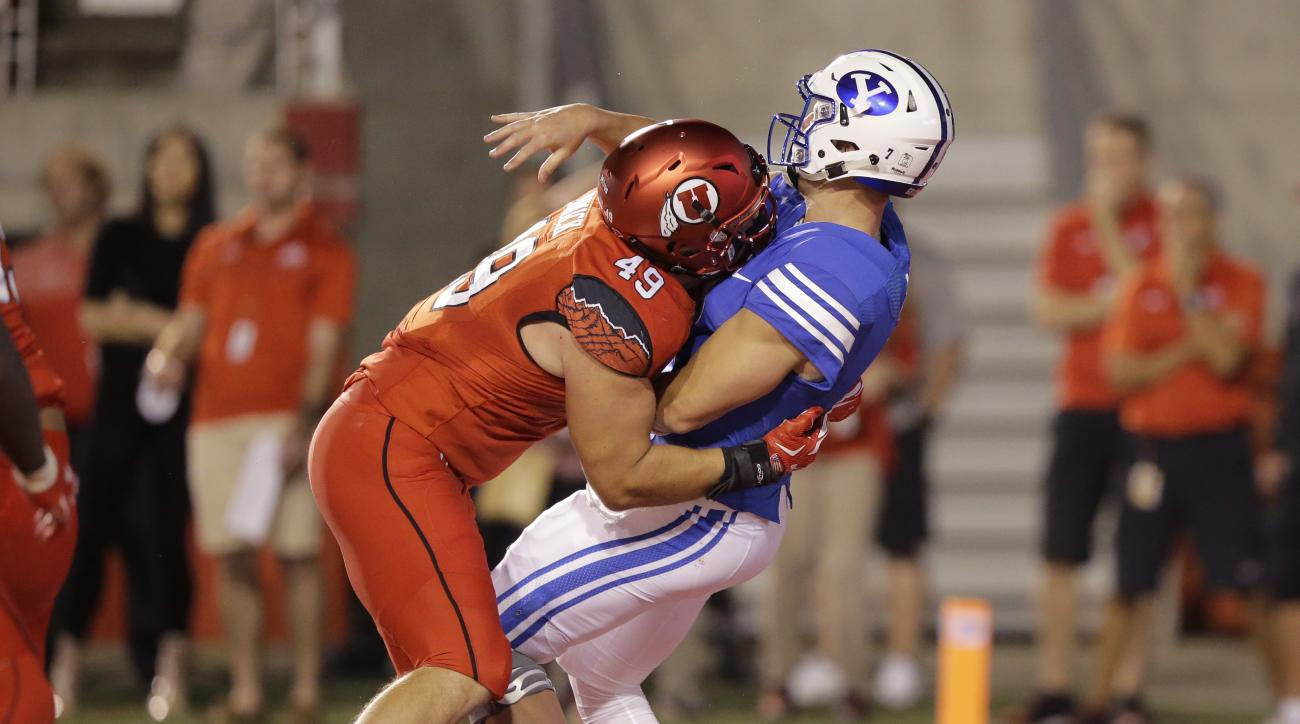 FILE - This Sept. 10, 2016, file photo, Utah defensive end Hunter Dimick (49) hits BYU quarterback Taysom Hill, right, as he throws in the second half during an NCAA college football game, in Salt Lake City. Dimick shined as a redshirt sophomore in 2014 w