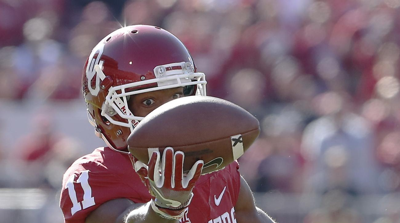 FILE - In this Nov. 12, 2016, file photo, Oklahoma wide receiver Dede Westbrook (11) eyes a catch against Baylors during the first half of a college football game in Norman, Okla. Louisville quarterback Lamar Jackson has all but wrapped up the Heisman Tro
