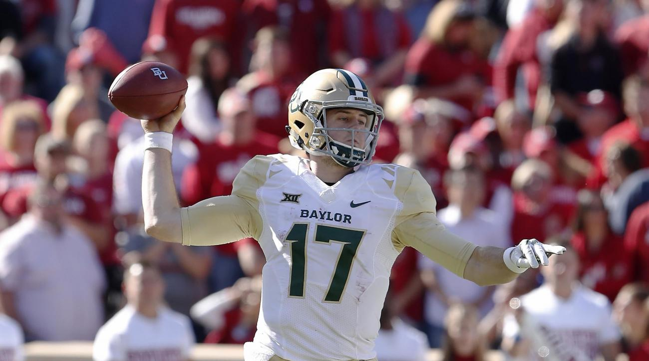 FILE - In this Saturday, Nov. 12, 2016 file photo, Baylor quarterback Seth Russell (17) passes against Oklahoma during the second half of a NCAA college football game in Norman, Okla. Baylor senior quarterback Seth Russell had surgery Wednesday, Nov. 16,