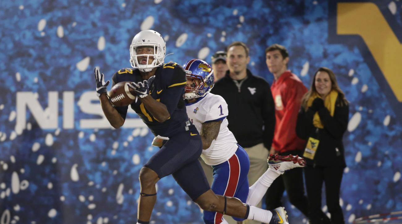 FILE - In this Nov. 5, 2016, file photo, West Virginia cornerback Rasul Douglas (13) intercepts a pass attended for Kansas wide receiver Rasul Douglas (1) during the second half of an NCAA college football game, in Morgantown, W.Va. Douglas has three inte