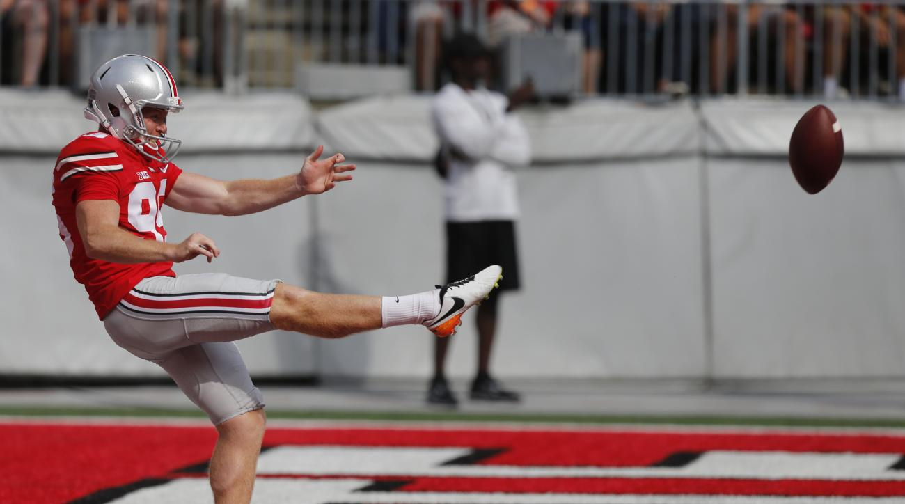 FILE - In this Sept. 19, 2016, file photo, Ohio State's Cameron Johnston punts against Tulsa during an NCAA college football game in Columbus, Ohio. The number of punt returns per game in the Bowl Subdivision since the start of the 2015 season is the lowe