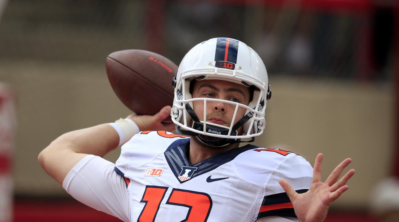 FILE -  In this Saturday, Oct. 1, 2016 file photo, Illinois quarterback Wes Lunt (12) warms up before an NCAA college football game against Nebraska in Lincoln, Neb. Lunt returned from injury in last weeks loss to Wisconsin. His offensive line hasnt given