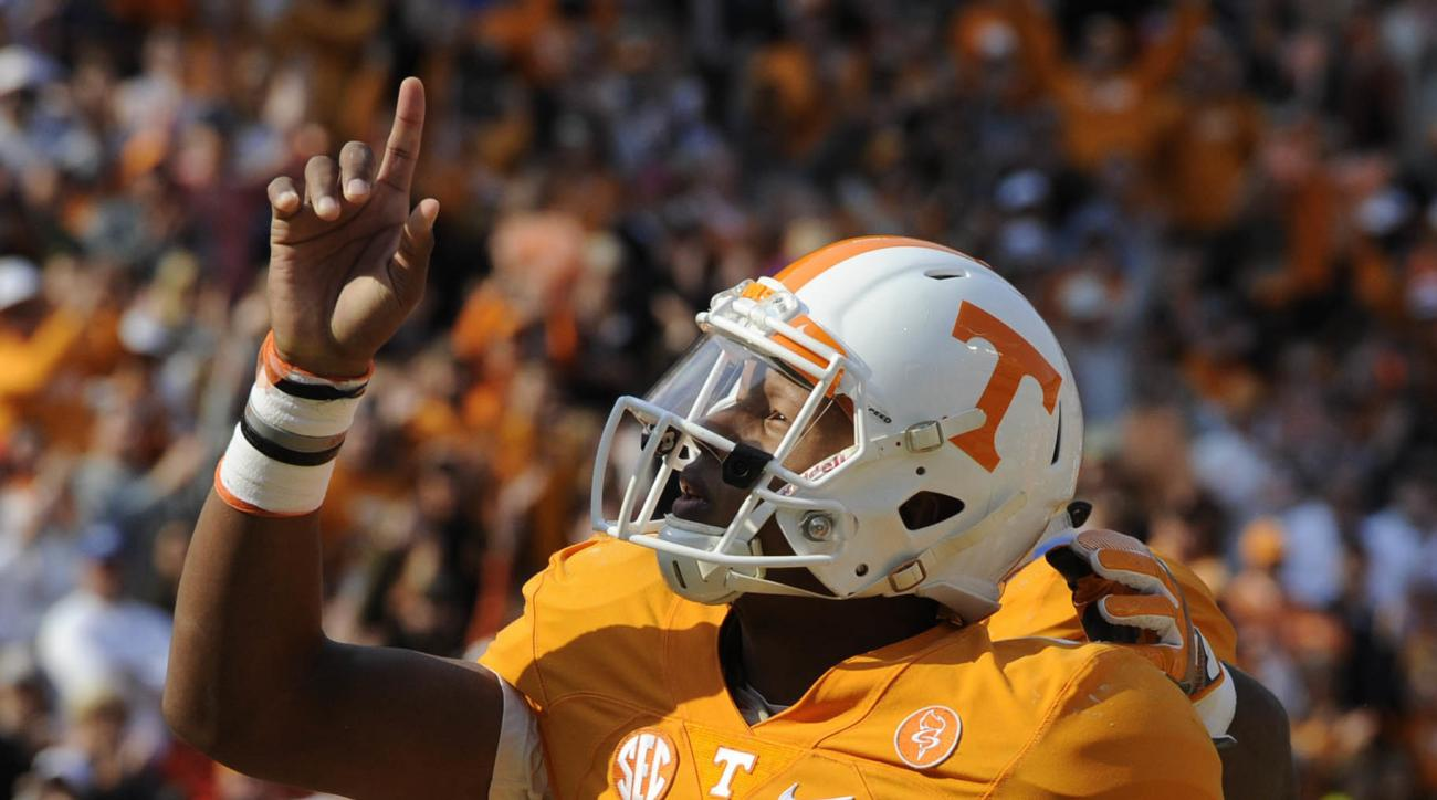 FILE - In this Nov. 12, 2016, file photo, Tennessee quarterback Joshua Dobbs (11) celebrates a one-yard run for a touchdown against Kentucky during the first half of an NCAA college football game at Neyland Stadium in Knoxville, Tenn. After beginning thei