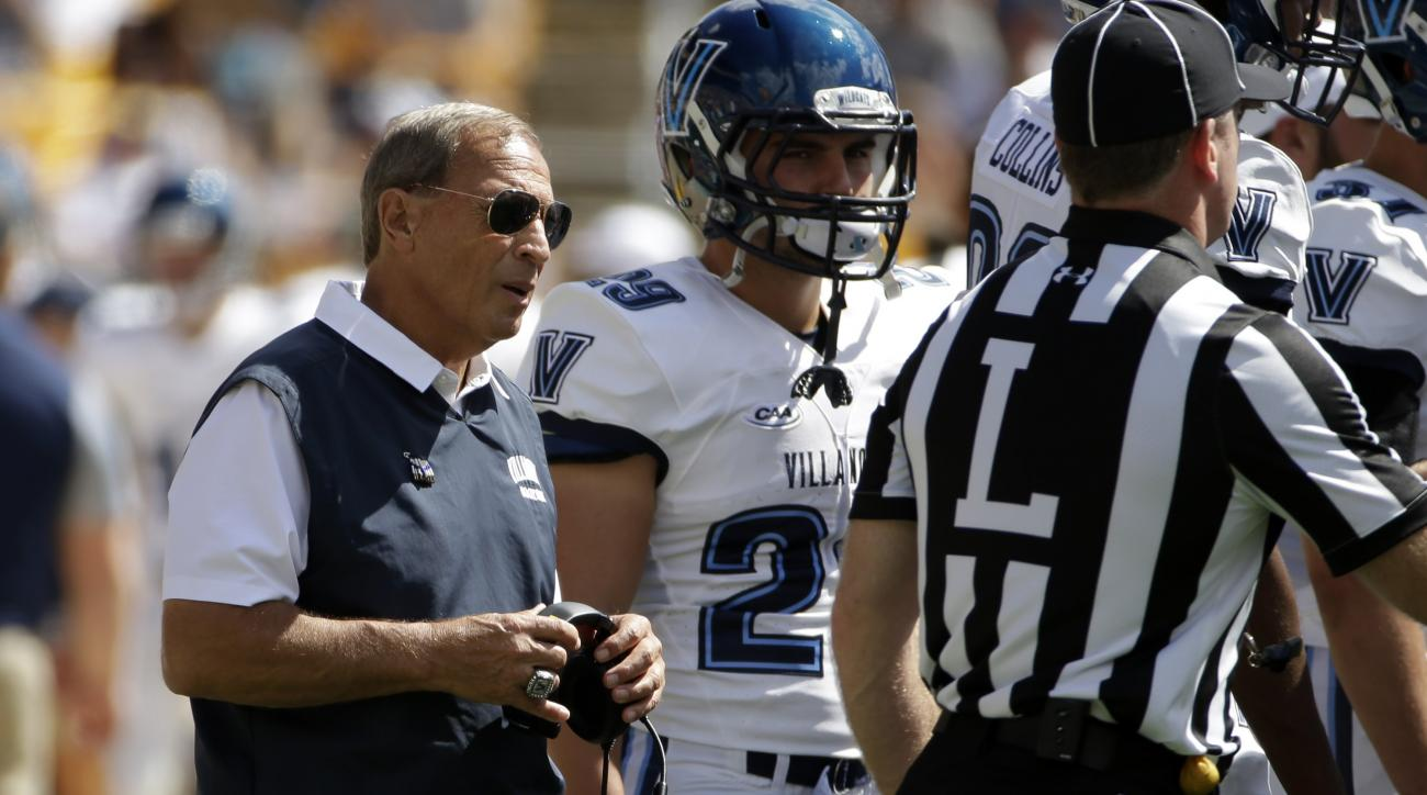 Villanova head football coach Andy Talley, left, meets with his team during a time out  during the first half of an NCAA college football game against Pittsburgh in Pittsburgh, Saturday, Sept. 3, 2016. (AP Photo/Gene J. Puskar)
