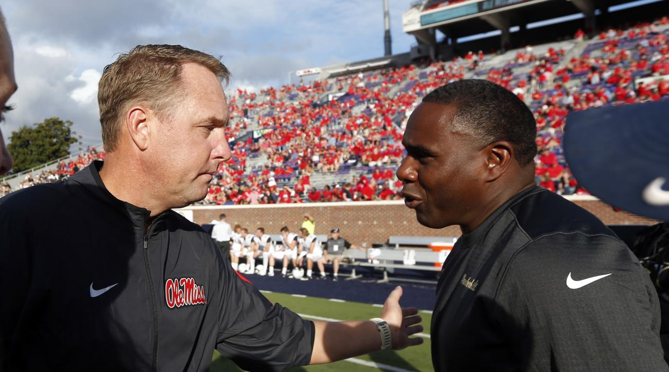 FILE - In this Sept. 26, 2015, file photo, Mississippi football coach Hugh Freeze, left, greets Vanderbilt football coach Derek Mason prior to their NCAA college football game, in Oxford, Miss. The Commodores (4-6, 1-5 Southeastern Conference) are hosting