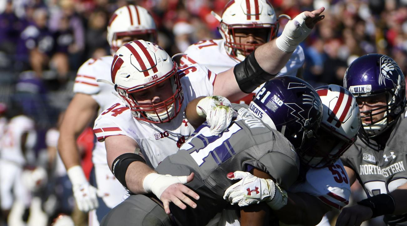 FILE - In this Nov. 5, 2016, file photo, Wisconsin defensive end Conor Sheehy (94) tackles Northwestern running back Justin Jackson (21) during the first half of an NCAA college football game in Evanston, Ill. Linebacker Vince Biegel attributes Wisconsins