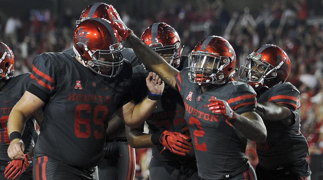 Houston running back Duke Catalon (2) celebrates his 13-yard touchdown reception during the first half of an NCAA college football game against Louisville, Thursday, Nov. 17, 2016, in Houston. (AP Photo/Eric Christian Smith)