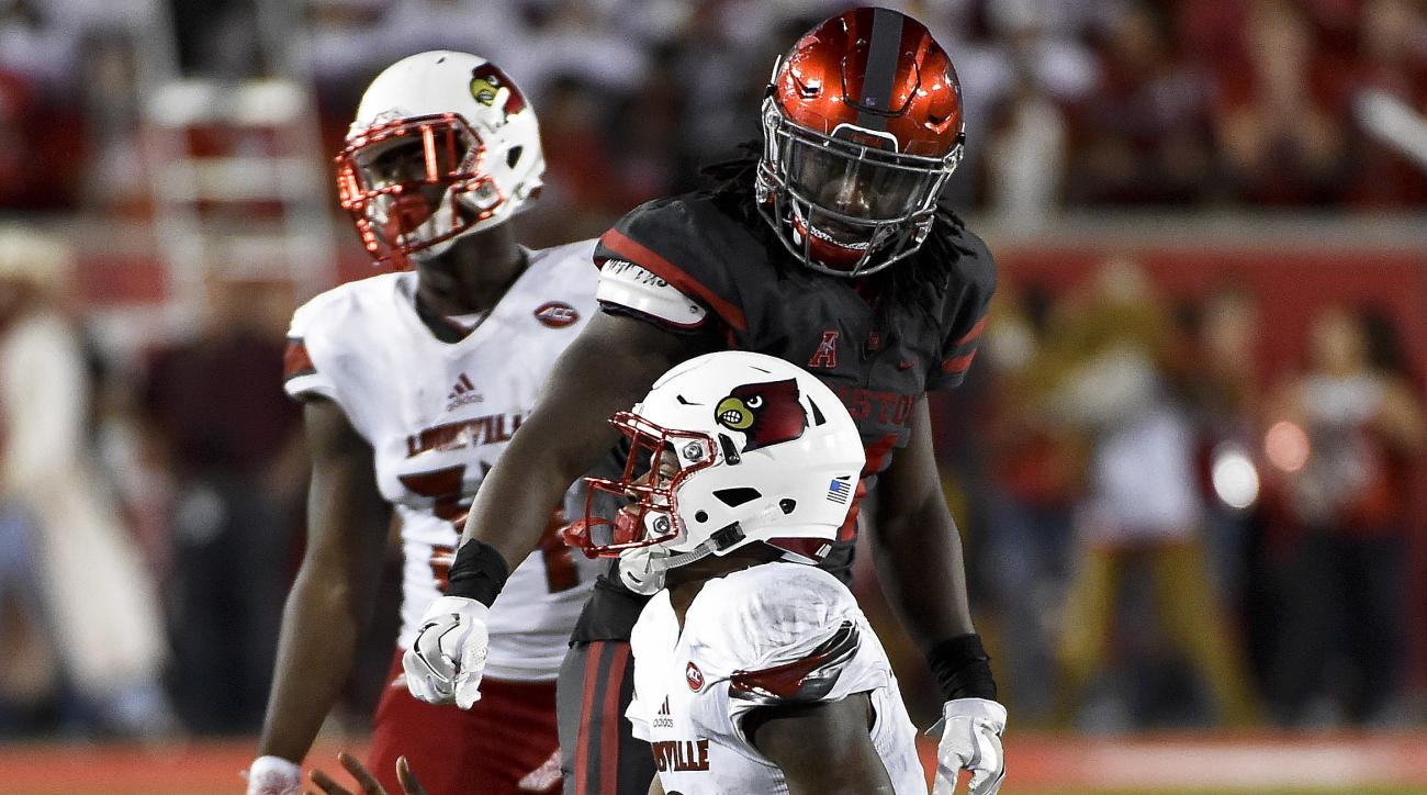 Houston linebacker Steven Taylor, top, stares at Louisville quarterback Lamar Jackson after tackling Jackson for a loss during the second half of an NCAA college football game, Thursday, Nov. 17, 2016, in Houston. Houston won 36-10. (AP Photo/Eric Christi