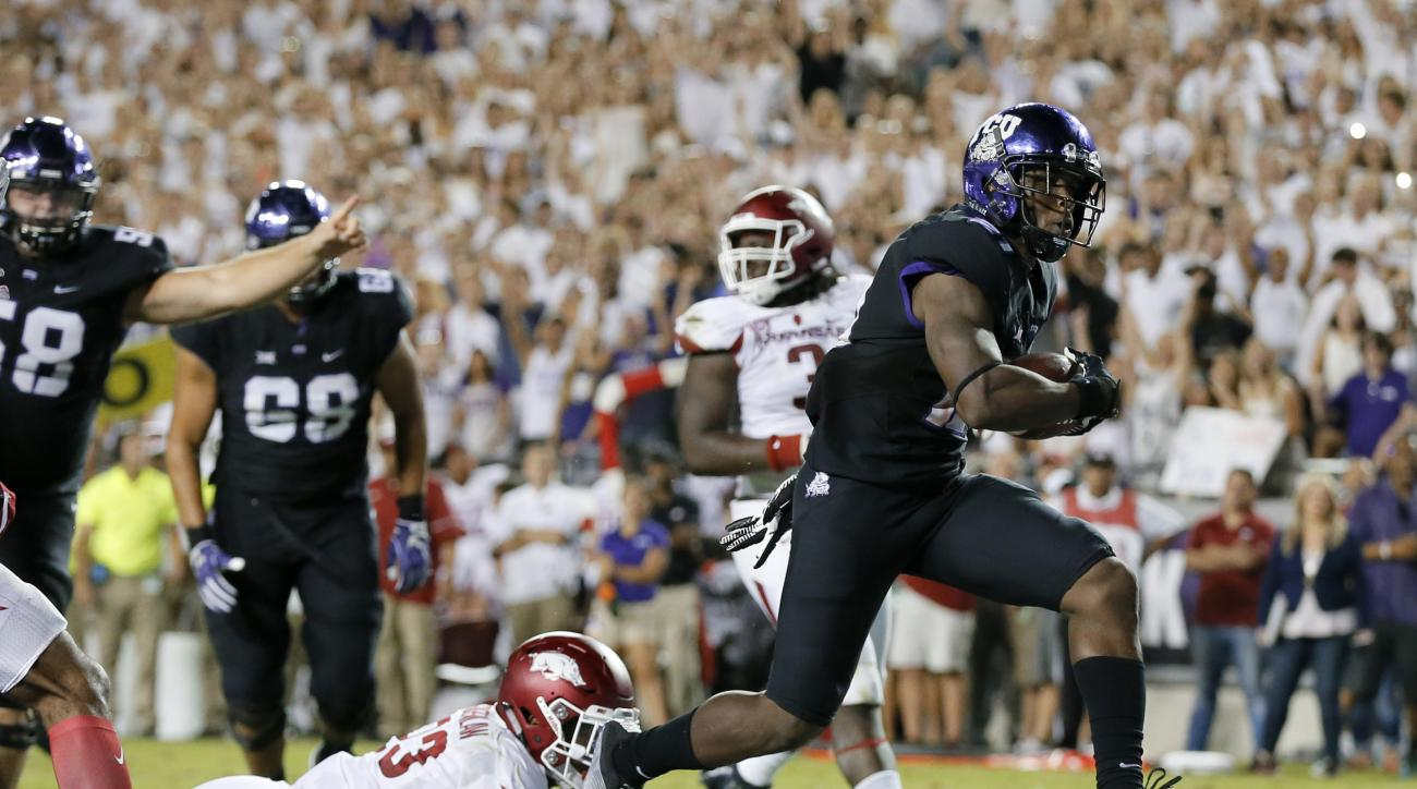 FILE - In this Sept. 10, 2016, file photo, Arkansas linebacker Dre Greenlaw (23) is unable to stop TCU running back Kyle Hicks on a touchdown during an NCAA college football game in Fort Worth, Texas.  Hicks and Oklahoma State freshman Justice Hill both h