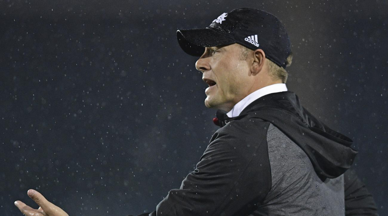 FILE- In this Nov. 8, 2016, file photo, Western Michigan head coach P.J. Fleck disputes a penalty in the third quarter of an NCAA college football game against Kent State in Kent, Ohio. Western Michigan plays Buffalo on Saturday, Nov. 19. (AP Photo/David