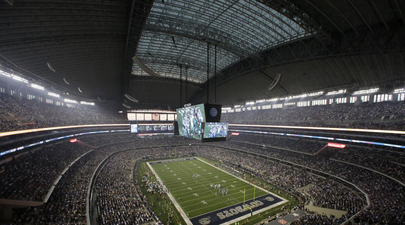 Fans watch at the start of an NFL football game inside AT&T Stadium between the New York Giants and Dallas Cowboys, Sunday, Sept. 8, 2013, in Arlington, Texas. (AP Photo/Tony Gutierrez)