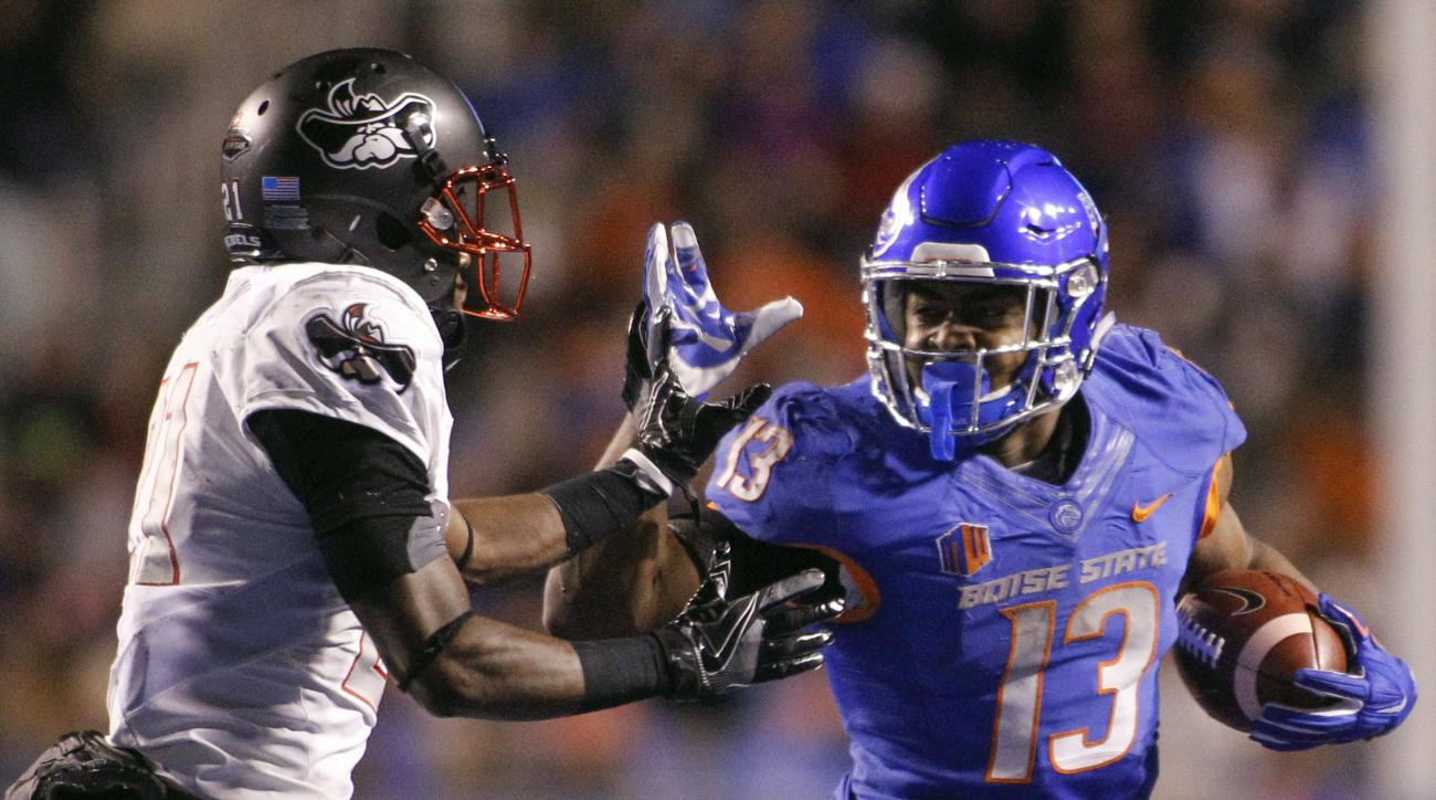 Boise State running back Jeremy McNichols (13) runs the ball against UNLV defensive back Darius Mouton (21) during the second half of an NCAA college football game in Boise, Idaho, Friday, Nov. 18, 2016. Boise State won 42-25. (AP Photo/Otto Kitsinger)