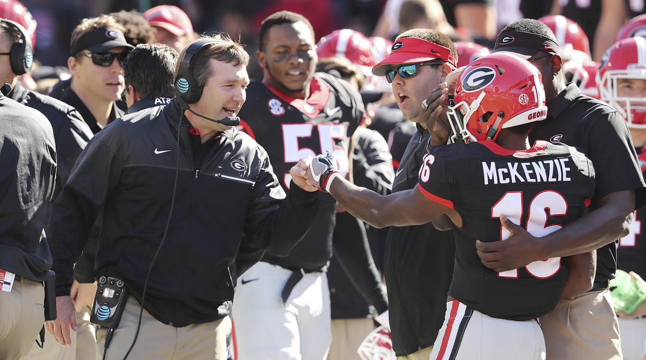 Georgia wide receiver Isaiah McKenzie gets a fist bump from head coach Kirby Smart after returning a punt against Louisiana-LaFayette for a touchdown during the first quarter in an NCAA college football game on Saturday, Nov. 19, 2016, in Athens. (Curtis