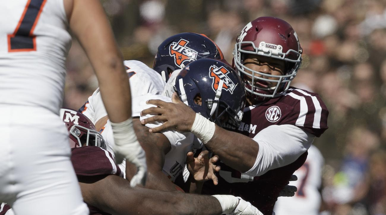Texas A&M defensive lineman Myles Garrett, right,m sacks UTSA quarterback Jared Johnson (15) during the second quarter of an NCAA college football game Saturday, Nov. 19, 2016, in College Station, Texas. (AP Photo/Sam Craft)