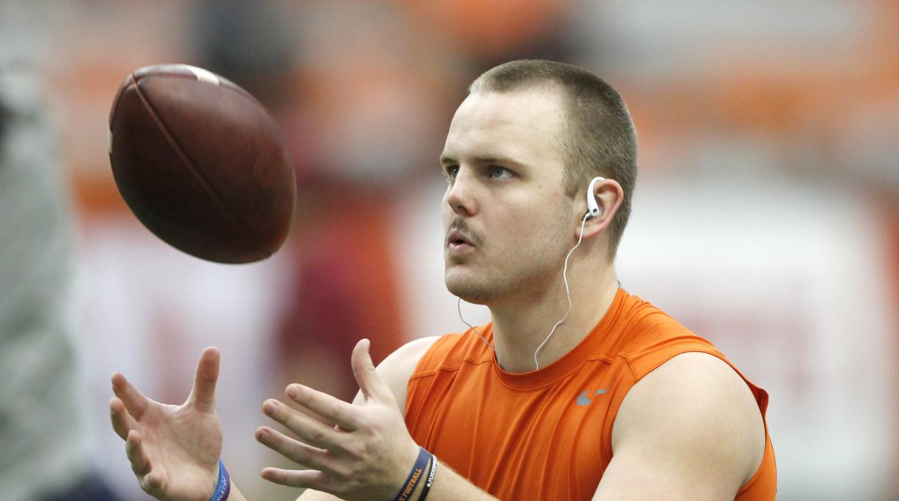 Syracuse's Zack Mahoney tosses the ball during warm-ups before an NCAA college football game against Florida State in Syracuse, N.Y., Saturday, Nov. 19, 2016. (AP Photo/Nick Lisi)