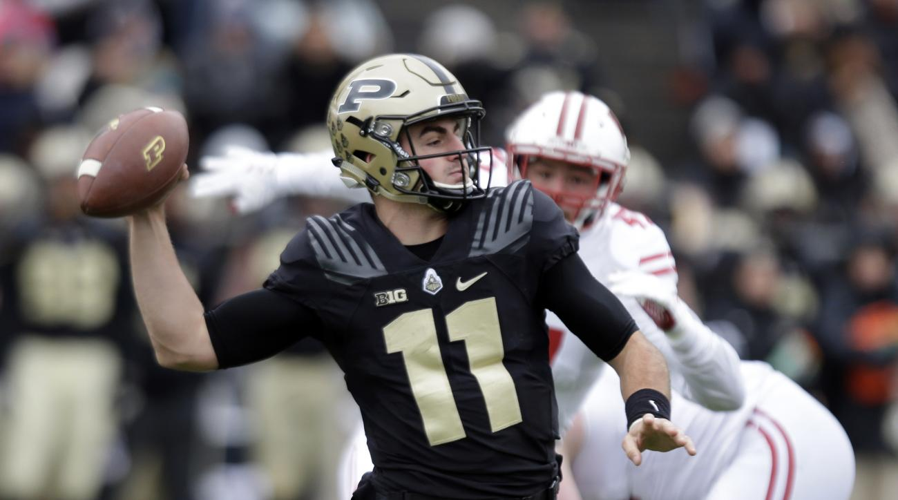 Purdue quarterback David Blough (11) throws against the Wisconsin during the second half of an NCAA college football game in West Lafayette, Ind., Saturday, Nov. 19, 2016. Wisconsin defeated Purdue 49-20. (AP Photo/Michael Conroy)
